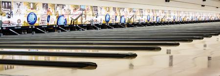 glisten: Las Vegas, NV, USA - January 10, 2015: Bowling lanes glisten in prepartion for a championship tournament at the Gold Coast Hotel and Casino in Las Vegas.