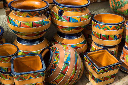 Traditional glazed Mexican talavera style pottery in southwestern patterns. Stock Photo