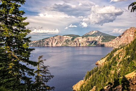Late afternoon clouds frame the dramatic vista at Crater Lake National Park.