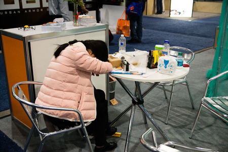 Las Vegas, NV - Jan. 9, 2016: A visitor to the 2016 CES exhibition is worn-out after attending the worlds largest trade show in Las Vegas.