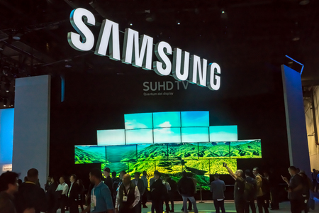 Las Vegas, NV -  January 8, 2016: Attendees flock to the Samsung exhibit at the Consumer Electronics Show, the world's largest trade show, convention and exhibition.