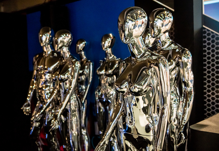 Las Vegas, NV -  Jan. 9, 2016: A group of chrome alien beings at the 2016 CES show in Las Vegas, NV.