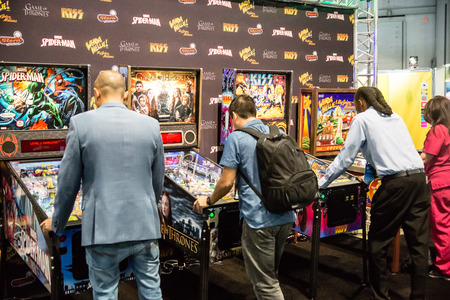 pinball: Las Vegas, NV - Jan. 8, 2016: Visitors to the 2016 Consumer Electronics Show CES test their skills on a new generation of pinball games in Las Vegas.