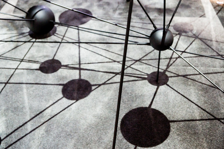 inter: Spheres and shadows creat an abstract symbolizing atomic structure. Stock Photo