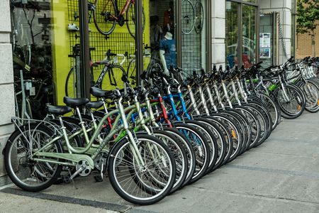 Quebec City, Quebec, Canada - Sept. 9, 2015: Rental bicycles are  arranged along a sidewalk before an international grand prix cycling event in Old Quebec.