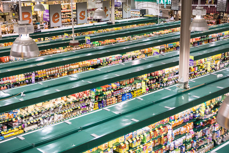 multi story: Falls Church, VA, USA - October 25, 2015: An unusual high vantage point provides an overview of a modern, tw0-story grocery store catering to demands for quality and organic products. Editorial