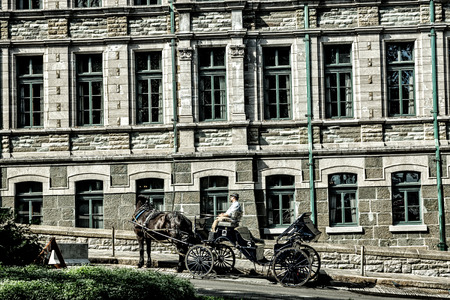Quebec City, Quebec, Canada - Sept. 10, 2015: Horse-drawn carriages take tourists to visit the sights in charming Old Quebec  City. The walled city is a UNESCO World Heritage Site.