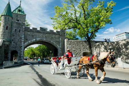 Quebec City, Quebec, Canada - Sept. 10, 2015: Horse-drawn carriages take tourists to visit the sights in charming Old Quebec  City.