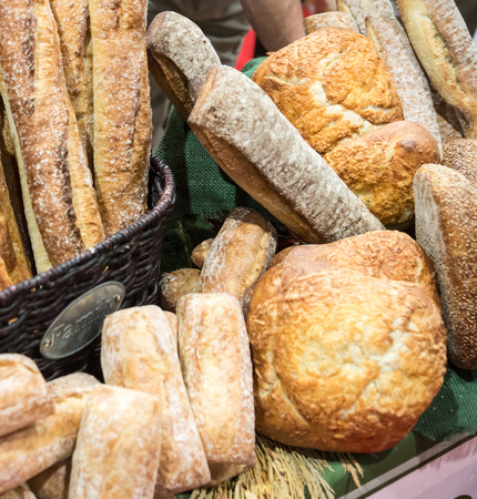 discriminating: Bakers display a variety of artisan breads and rolls for discriminating tastes.