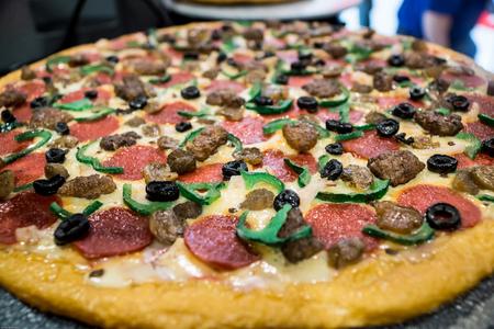 pizza pie: Fresh-baked pepperoni pizza pie. Stock Photo