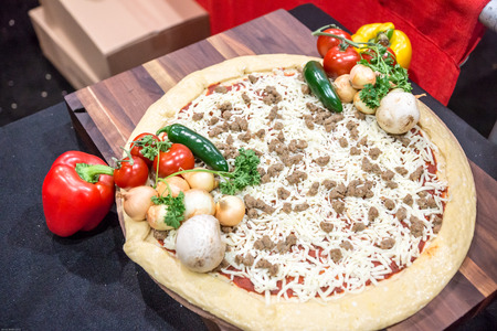 A perfectly appointed pizza still life, ready for the oven.