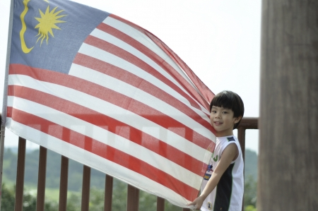 Proud Malaysian holding flag