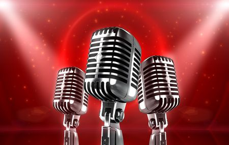 particles: Vintage silver Microphones with glowing particles and stage lights Stock Photo