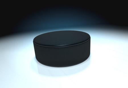 Ice hockey puck on ice with mirror photo