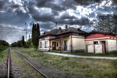 Abandon Old train station without trains with dramatically sky photo