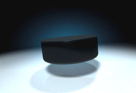 Flying ice hockey puck with cold ice photo