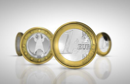 multiplying: Rotating one euro coins are multiplying Stock Photo