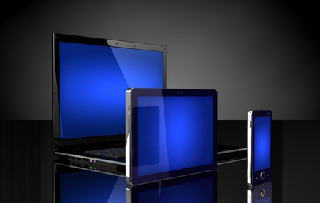 Laptop, tablet and mobile phone  with blue screens on black photo