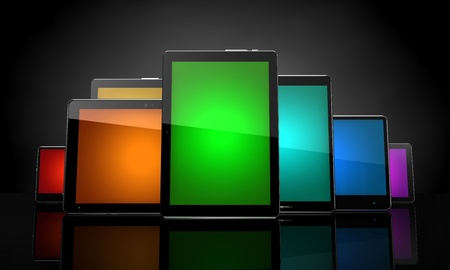 Digital pads with colorful touchscreens on black photo