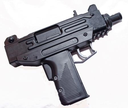 A black machine gun pistol on a white background