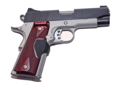 Multi colored 1911 pistol on a white background Stok Fotoğraf - 94688343
