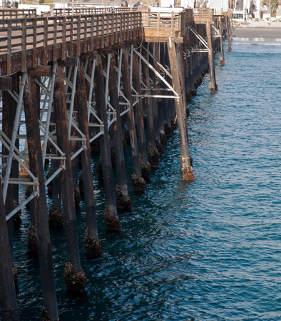 A wooden pier and the Pacific ocean in Oceanside, California, USA Stock Photo
