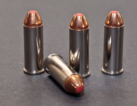 Four 44spl bullets with red tips on a gray background