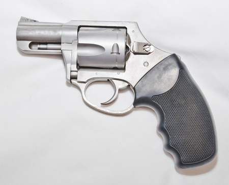 A stainless steel 357 magnum revolver with a black handle on a white background Reklamní fotografie - 115023469