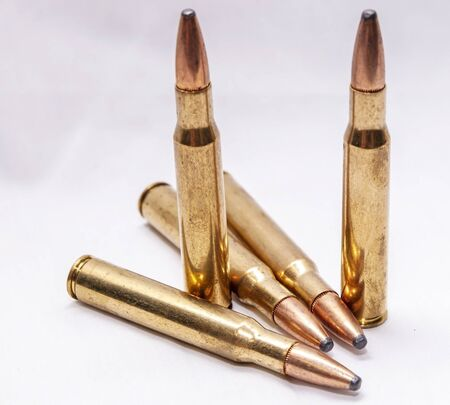 Five brass hunting bullets on a white background 版權商用圖片