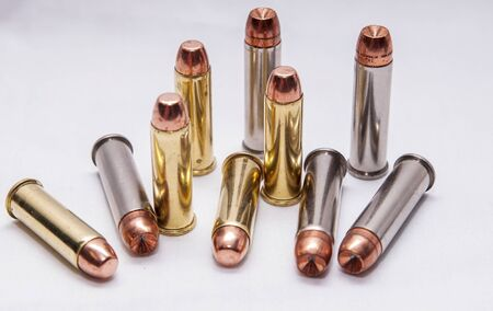Ten different bullets, 357 magnum and 40 caliber together on a white background