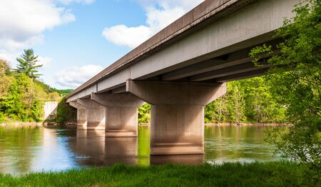 A bridge over the Allegheny River on State Route 62 in Warren County, Pennsylvania, USA on a sunny spring day