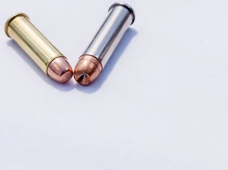 Two hollow point bullets, a 357 and 38 caliber on a white background with room for text