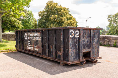 Pittsburgh, Pennsylvania, USA 6/21/20 A black colored privately owned 30 yard dumpster in a parking lot at a construction site