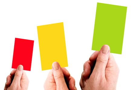 Hands holding red, yellow and green card Stock Photo