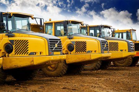 Row of yellow heavy tipper trucks Stock Photo - 7852497