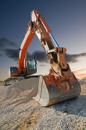 Orange coloured heavy construction digger