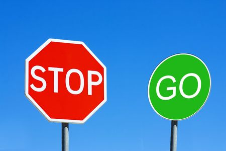 Stop and Go sign against a blue sky Stock Photo