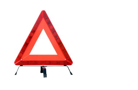 Red plastic warning triangle isolated against a white background