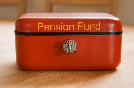 Red metal pension fund savings tin Stock Photo