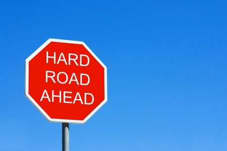 Hard Road Ahead road sign against a clear blue sky Archivio Fotografico