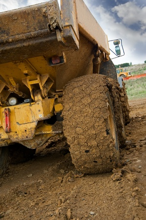 payload: Tipper truck with muddy rear wheel
