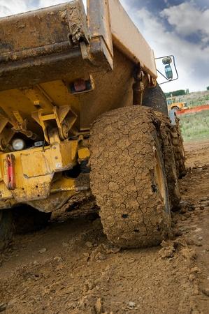 dumptruck: Tipper truck with muddy rear wheel