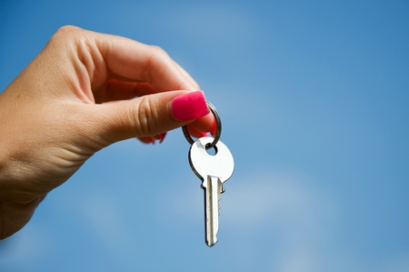 Hand With Key Stock Photo - 10190789