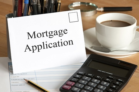 first time buyer: Mortgage application concept with envelope, calculator and pencil Stock Photo