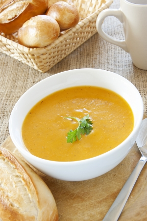 potato soup: A bowl of carrot & coriander soup garnished with green coriander leaf Stock Photo