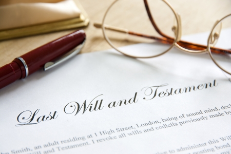 solicitor: Last Will and Testament concept image complete with spectacles and pen.