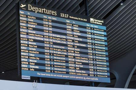 ROME, ITALY - OCTOBER 30, 2019: Table of departures in Rome Leonardo da Vinci or Fiumicino Airport (Aeroporti di Roma in Italian) 新闻类图片