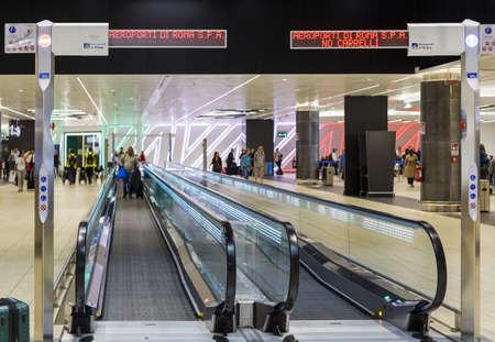 ROME, ITALY - OCTOBER 30, 2019: Moving walkways in departure area in Rome Leonardo da Vinci or Fiumicino Airport (Aeroporti di Roma in Italian) 新闻类图片