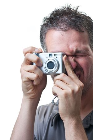 A man shooting with a small digital camera, isolated on white.