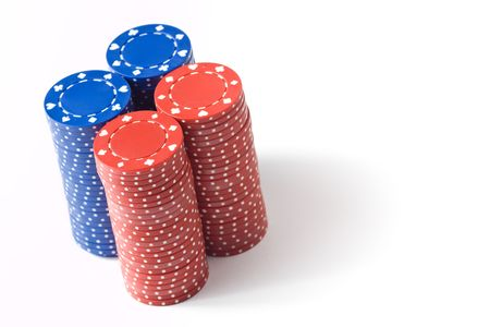 4 stacks of blue and red poker chips, isolated on white